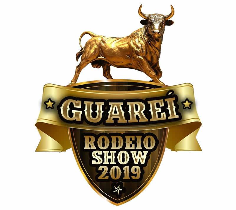 Logotipo do evento composto de um touro sobre faixa e brasão onde se lê Guareí Rodeio Show 2019. Tudo nas cores dourado e preto