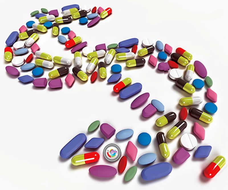 Comprimidos de várias cores, formas e tamanhos agrupados e formando um cifrão